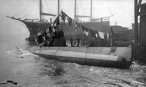 THEN: The new sub H-3 takes her inaugural baptism at the Seattle Construction and Dry Dock Company's ways on Independence Day, 1913. (Courtesy, Ron Edge)