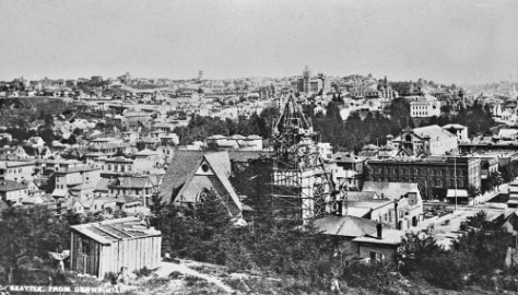 The University campus on its knoll, upper-right, and the First Methodist's are building their tower at the southeast corner of Pine and 3rd, ca. 1890.