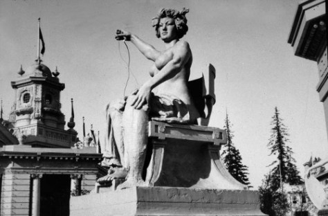 Another Arctic Circle statue with a commanding female holding a salmon in one hand and an electric wire in the other.   This too was part of the Arctic Circle ensemble of hydraulics and Beau Art buildings.  (Photo by Lou Hudson.)