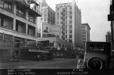 Looking west through the intersection of 5th and Pike on Feb. 10, 1926.  This is another of many negatives made for the Foser Kleiser billboard company.  The centerpiece here is the smart Camel smoker.