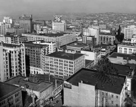 "An ""aerial"" from the top of the then new Washington Athletic Club at the southeast corner of 6th and Union. Please take note of both the Blue Mouse Theatre and to its side Don's Seafood Restaurant, both on the west side of 5th between Union and Pike.  Don's was later purchase by Ivar Haglund for his first ""fancy"" restaurant, Ivar's Fifth Avenue.  It later got a name change to the Captain's Table before it was moved to the waterfront near the foot of Denny Way."