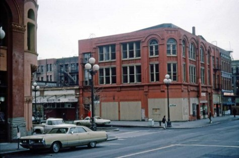 At the other end of the block, the southwest corner of Yesler Way and Occidental Ave., the affected Korn Building beneath which Underground Seattle tours excite tourists with tales of toilets and the Great Fire.