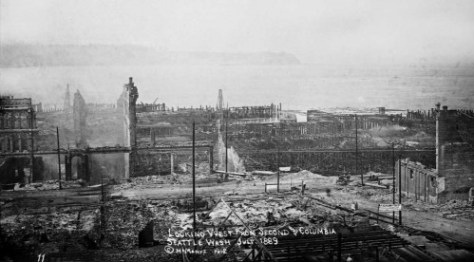 Columbia Street, on the right, heads west to Front Street (First Ave.) and what remains of Seattle's brick show strip in the late 1880s.  The ruins of the fire station on the south side of Columbia have been cleared - it seems - and work on a temporary platform for the raising of a business tent shows bottom-right.  (Courtesy Michael Maslan)