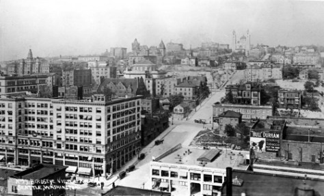 The intersection of Third Ave. and Columbia Street is bottom-center. In the place of the Rainier Hotel, the block has been graded with a plateau, of sorts - above the center of the subject.