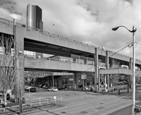 Jean used his 10-foot camera extension pole to reach the elevated but long since lost platform used by Hughett.  The Marion Street viaduct seems further away because it is.  The passenger bridge was pivoted south some during the 1951-52 construction of the Alaskan Way viaduct.