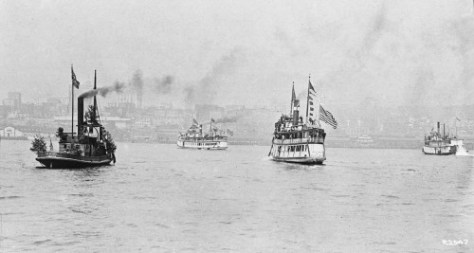 The Kitsap, right-of-center, joins the 1911 flotilla celebrating the year's Golden Potlatch celebration.