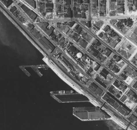 The 1936 aerial from the same sky but with a new Railroad Avenue beside a new seawall.