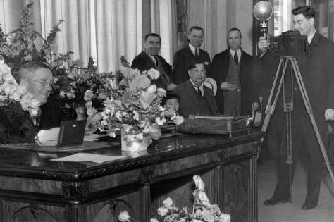The fresh Mayor John Dore at his flower bedecked desk after winning the 1932 election.