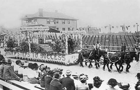 X-Potlatch-parade,-1911-a-business-school-float-horse-pulled,-bleachers-maslanWEB