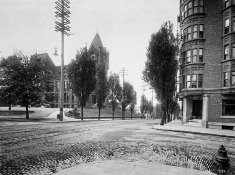 THEN: Looking west on Madison Street from Seventh Avenue circa 1909. (Courtesy, Washington State Museum, Tacoma)