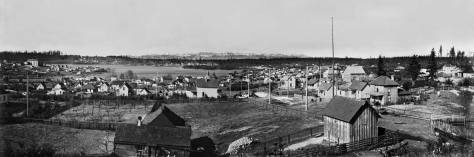 An A. Curtis 1903 pan looking west over Green Lake to Phinney Ridge with an Olympic Mountains horizon.  This is but two parts of a pan that continues for another third into Wallingford, here out-of-frame to the left.
