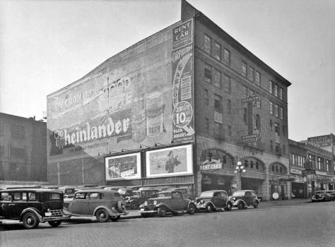 Looking southwest thru the block in 1937 with the Orpheum Auto Hotel next door to