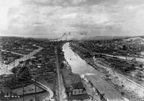 "An ""aerial"" panorama (perhaps shot from the tower showing above the south pier in the photograph two above this one) looking west down the canal on May 4, 1916."