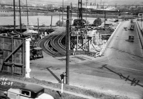 At least from my print, the full date, bottom-left, for this look into the construction on the new interchange is cut off.  The view looks northeast.  (Courtesy, Lawton Gowey)