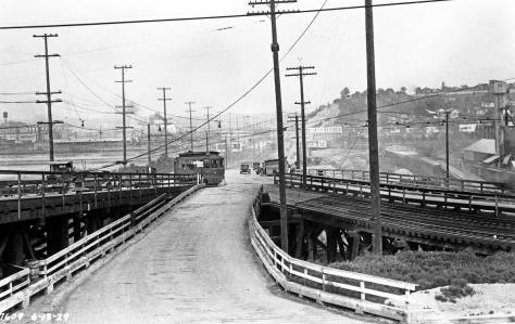 A month earlier on June 6, 1929 looking east over the same Spokane Street approach to West Seattle (proper) with construction begins on new concrete ramps for the Avalon-Spokane-Harbor-Admiral nexus. (Courtesy, Seattle Municipal Archive)