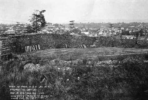 Same day, same photographer but with the loaded trucks on their deliveries.