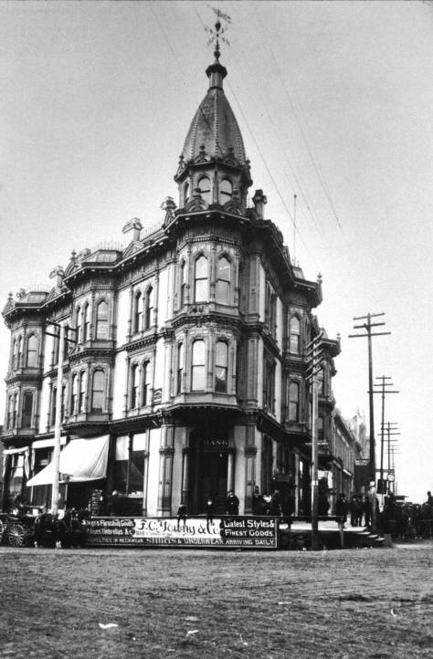 "The Yesler-Leary building at the northwest corner of Yesler and Front.   Like the rest of the neighborhood, including the Yesler's hanging trees, it was destroyed during the ""Great Fire"" of 1889."