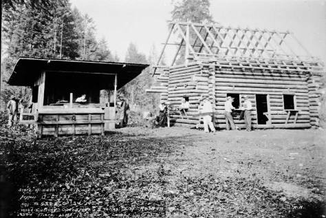 W.E.R.A. skilled labor constructing a log cabin on Oct.2,1934 about two miles east of Renton, (which may help one find it.)