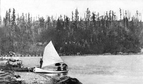 THEN: Captioned Salmon Bay, 1887, this is most likely very near the eastern end of the bay where it was fed by Ross Creek, the Lake Union outlet. (Courtesy, Michael Maslan Vintage Posters and Photographs)