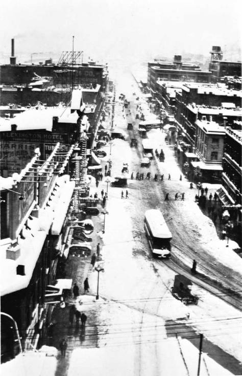 Second Avenue South from an office floor in the Smith Tower.  Most likely this is a scene from the big snow of 1916.  Second is still a dozen years from being cut through the buildings on the left.