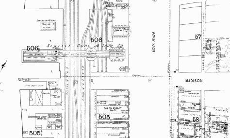 This detail, pulled from the 1893 Sanborn real estate map, shows the coal bunkers on the left and the trestle (for the coal) over Railroad Avenue and to the coal facilities between Railroad Avenue and Western Ave.  The next photo below looks up Madison from that trestle in 1890 or 1891.