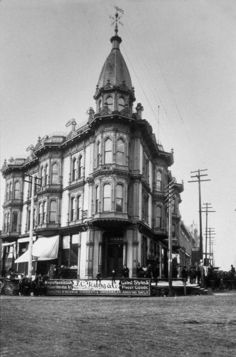 The Yesler Leary Building at the northwest corner of Mill Street (Yesler Way) and Front Street (First Avenue.)  Leary's partnership in the 1884 construction of this Victorian showpiece is a sign of his local power at the time.