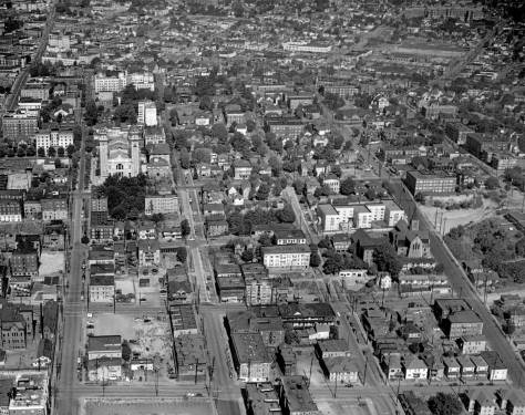 A 1950 aerial with Marion Street climbing First Hill far right.  That makes the next thruway up the hill Columbia Street.  New the upper-left corner it reaches the early Swedish Hospital in 1950 on the Rininger corner with Summit Ave.  Sixth Avenue runs along the bottom of the subject, between James Street on the right and Marion.  A little more than a decade later the blocks between Sixth and Seventh were cleared for the Seattle Freeway, as it was then called.  (Courtesy, Ron Edge)