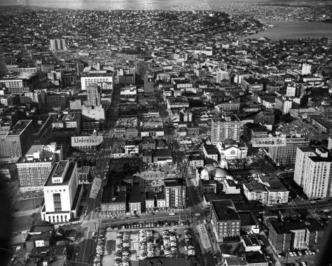 An aerial of the future freeway route through the Central Business District, including planned freeway's curve to the northeast north of Spring Street.  The curve that will cut through the southeast corner of Seneca and 7th Avenue  was marked here  near the center by someone long ago.  (Courtesy, Ron Edge)