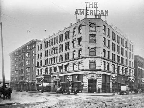 The American Hotel at the northeast corner of the new Fourth Ave. and Pike Street configuration.  Building on the future Seaboard building soon resume with many floors added above these five.