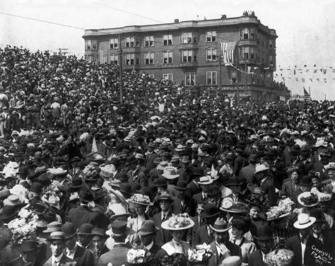 "Date 1908, bottom-right corner, this view looks north from near Stewart Street at the crowds probably gathered to witness the parade celebrating the 1908 visit of the ""Great White Fleet"" to Puget Sound."
