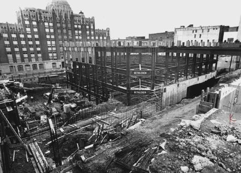 """Early construction on the Henry Jackson """"Federal"""" Building that replaced everything on the block except for a few ornaments saved from the Burke Building.  The older Federal Building appears here across First Avenue, and sits there still."""