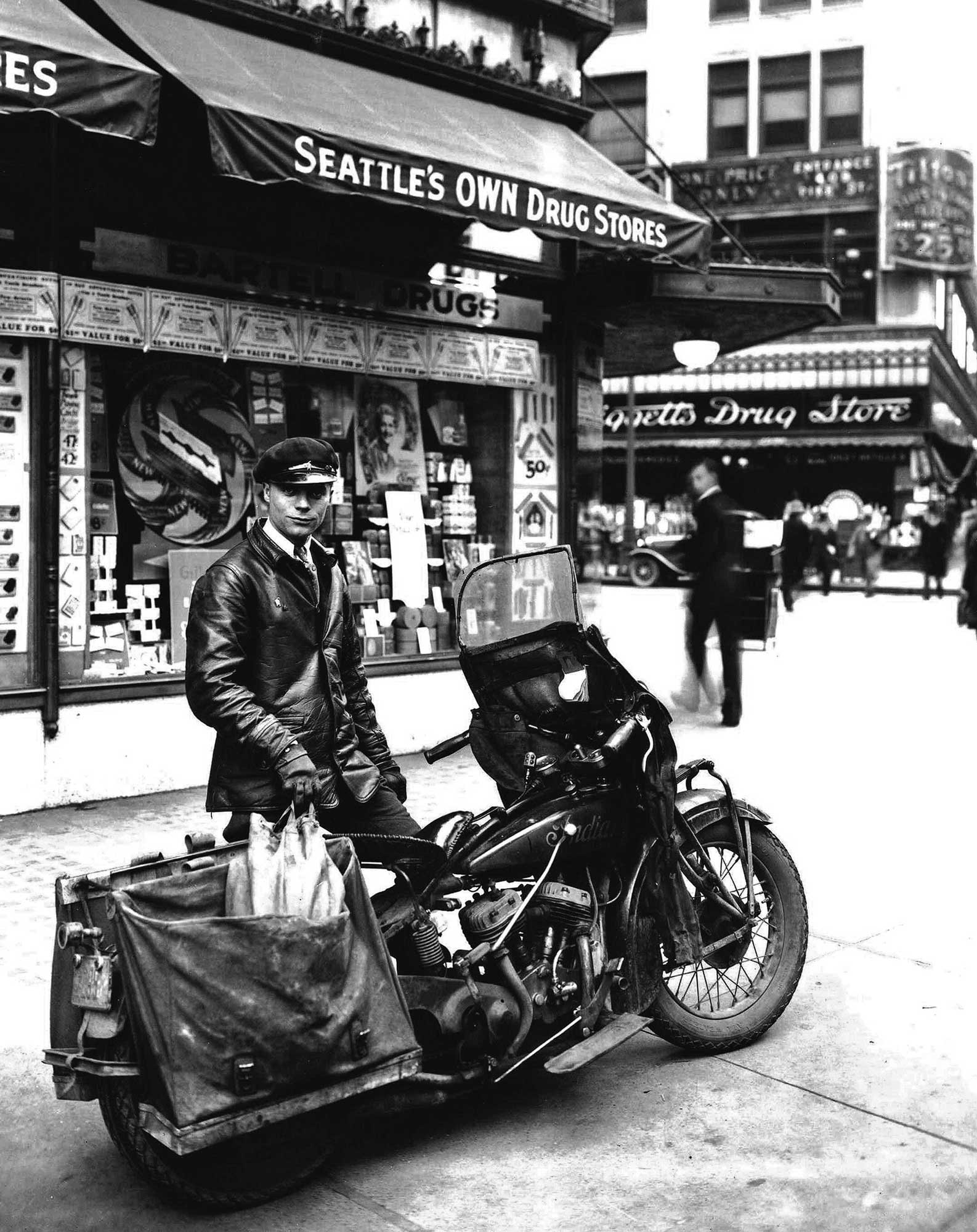 THEN: A motorcycle courier for Bartell Drugs poses before the chain's Store  No. 14