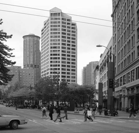 "I took this ""now"" repeat for the ""cop"" picture in 2005 while on my way to a historylink staff meeting.   The link's office was then in the Joshua Green Building at the southwest corner of the intersection."