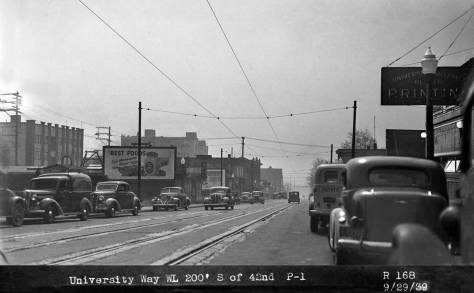 Five blocks up the Ave, from our featured home, and two years later on September 29, 1939, there are a few bricks to be seen here south of 42nd Avenue, those protecting the trolley rails.  The intended subject is - again - the Foster and Keiser billboard on the left.