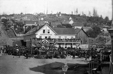 The First Hill Horizon in 1881 from Pioneer Place (Square) during the 1881 memorial service for the slain President Garfield.  In the past decade the hill was cleared of its forest and in the following decade it will be filled with homes, like the Boones, and institutions, like the Court House.  (Courtesy, Lawton Gowey)