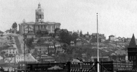 Another and only somewhat later of the Court House also from the King Street Wharf.  Here are the wide but long wooden steps up Terrace Street, on the left, another mast (but no pointing spreader) and the Boone home, also half-hidden in the landscape.
