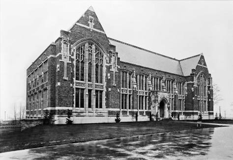 """THEN: Named for a lumberman, and still home for the UW's School of Environmental and Forest Sciences, the upper floor's high-ceilinged halls, including the Forest Club Room behind Anderson Hall's grand Gothic windows, were described for us by the department's gregarious telephone operator as """"very popular and Harry Potterish.""""   (Courtesy Lawton Gowey)"""