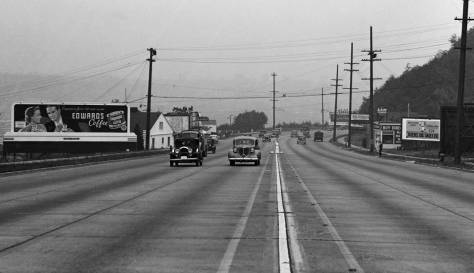 Looking south along the not-so-safe center-line of Aurora towards the Crockett Ave. safety island.  Below, is a detail from the same 1938 negative.