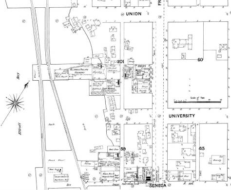 A detail from the 1888 Sanborn real estate map, which shows the development than along the waterfront and Front Street at the foot of University Street.  The footprint for the cracker factory is sketched bottom-center, and the two trestles south of the Schwabacher dock are show off shore.  It was there that the off-shore advance of the fire was stopped by a bucket brigade of more than two hundred volunteers.