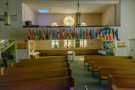 Flags at the back of the church represent the many nationalities of the congregation