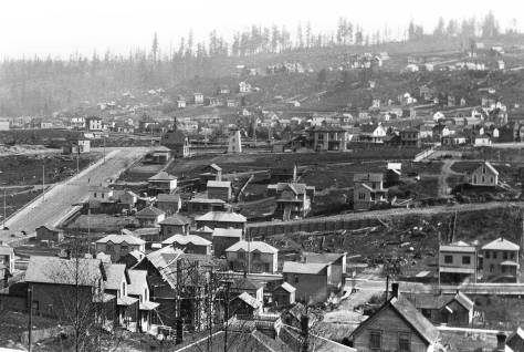 N.P.Railroad photographer, Jay Haynes look northeast from Denny Hill to Capitol Hill with the Cascade Neighborhood plateau below it.   Lenora Street descends on the left from Denny Way.   A decade later Norway Hall was built near where the larger home stands to the right of the pump house.