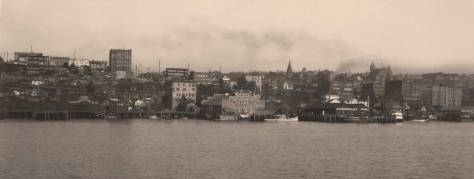 A rare look at the waterfront ca. 1897 with the Hotel York escaping the horizon on the right, at the northwest corner of Pike and Front/First Ave.   The Augustine