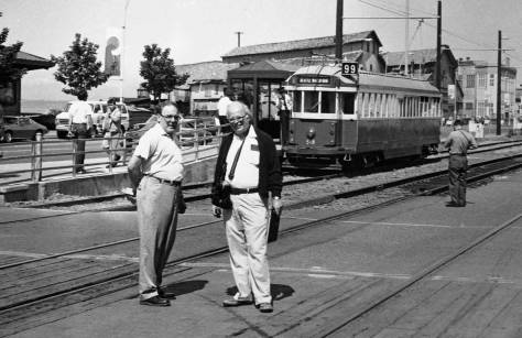 Lawton with camera and beside a friend below the Pike Street Hill Climb, and the then newly opened Waterfront Trolley, which was later mysteriously sent on vacation for, in part (or I believe) the needs of SAM's sculpture garden at the foot of Broad Street, home for the trolley's parking and maintenance.