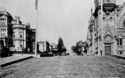 East along a planked Marion Street and thru its intersection with Third Avenue, with the Stacy Mansion on the left and the Methodists on the right, circa 1890.