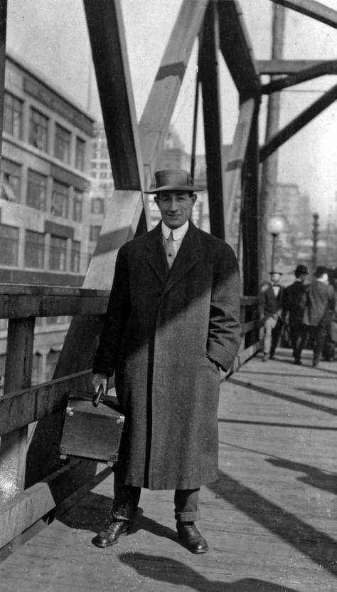 Posing on the Marion Street viaduct, Mach 3, 1911.  The scene looks east.