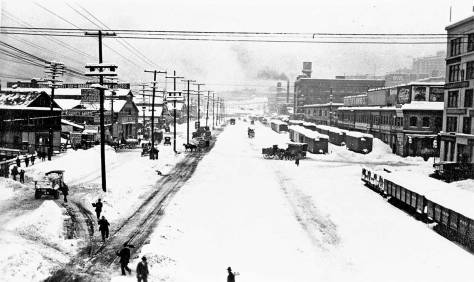 "Railroad Avenue from the Marion  Street viaduct during the 1916 ""Big Snow.""  The Madison Street north end of the building appears on the far right."