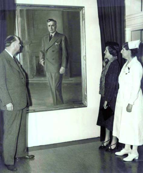 """A portrait of Dr. James Tate Mason painted by Neal Ordayne. The painting was given to the hospital by, its Seattle Times caption reads, """"nurses of teh staff and graduates of the hospital's nursing school, was unveiled by Mrs. Virginia Mason Elliott, Dr. Mason's daughter, for whom the hospital was named. In the picture are Dr. George A. Dowling, Mrs. Elliott and Miss Anna J. Fraser, at right, superintendent of the hospital."""" ca. 1937"""