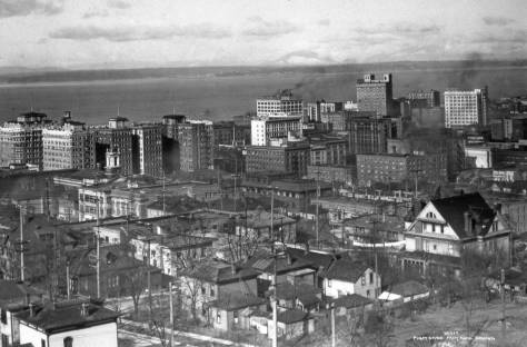 Like the featured photographs at the top, this too was taken by Asahel Curtis - perhaps on the same day, as one of the two on top.  As its own caption, lower-right, indicates this was taken from the hotel.  It looks northwest into the city's new and booming retail district.