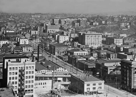 Both the Row House and the trolley barns to the north (left) across Pine Street can be found in this glimpse east from the New Washington Hotel at Second and Stewart.