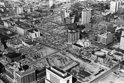 Freeway construction looking north through the razed swath much of which would later be given to first Freeway Park in 1976 followed by the Convention Center in the 1980s. Note, right-of-center, both town hall and the Exeter. Of course, the Cambridge is down there too. (Courtesy Ron Edge)